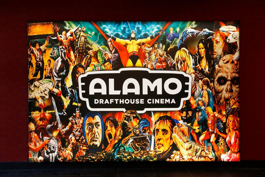 A light-up sign in the lobby of the new Alamo Drafthouse in Lake Highlands shows the current theme: '80s adventure movies.