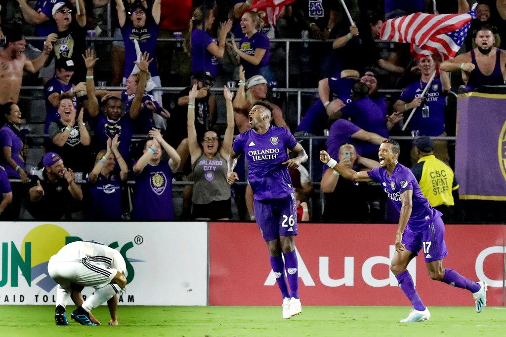 Orlando City defender Carlos Ascues (26) celebrates his goal against FC Dallas with teammate forward Nani (17) as FC Dallas midfielder Paxton Pomykal, left, reacts during the second half of an MLS soccer match, Saturday, Aug. 3, 2019, in Orlando, Fla. (AP Photo/John Raoux)