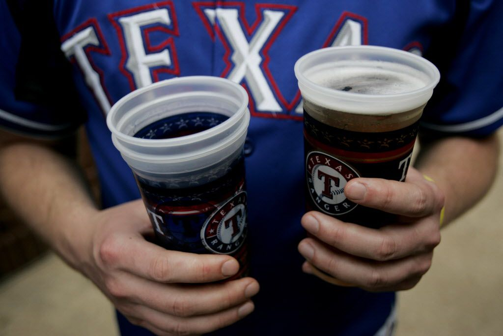 Hutch Hutchison holds onto a couple of beers  during opening day of Texas Rangers baseball on April 8, 2008, at Rangers Ballpark in Arlington. The Texas Rangers took on the Baltimore Orioles.