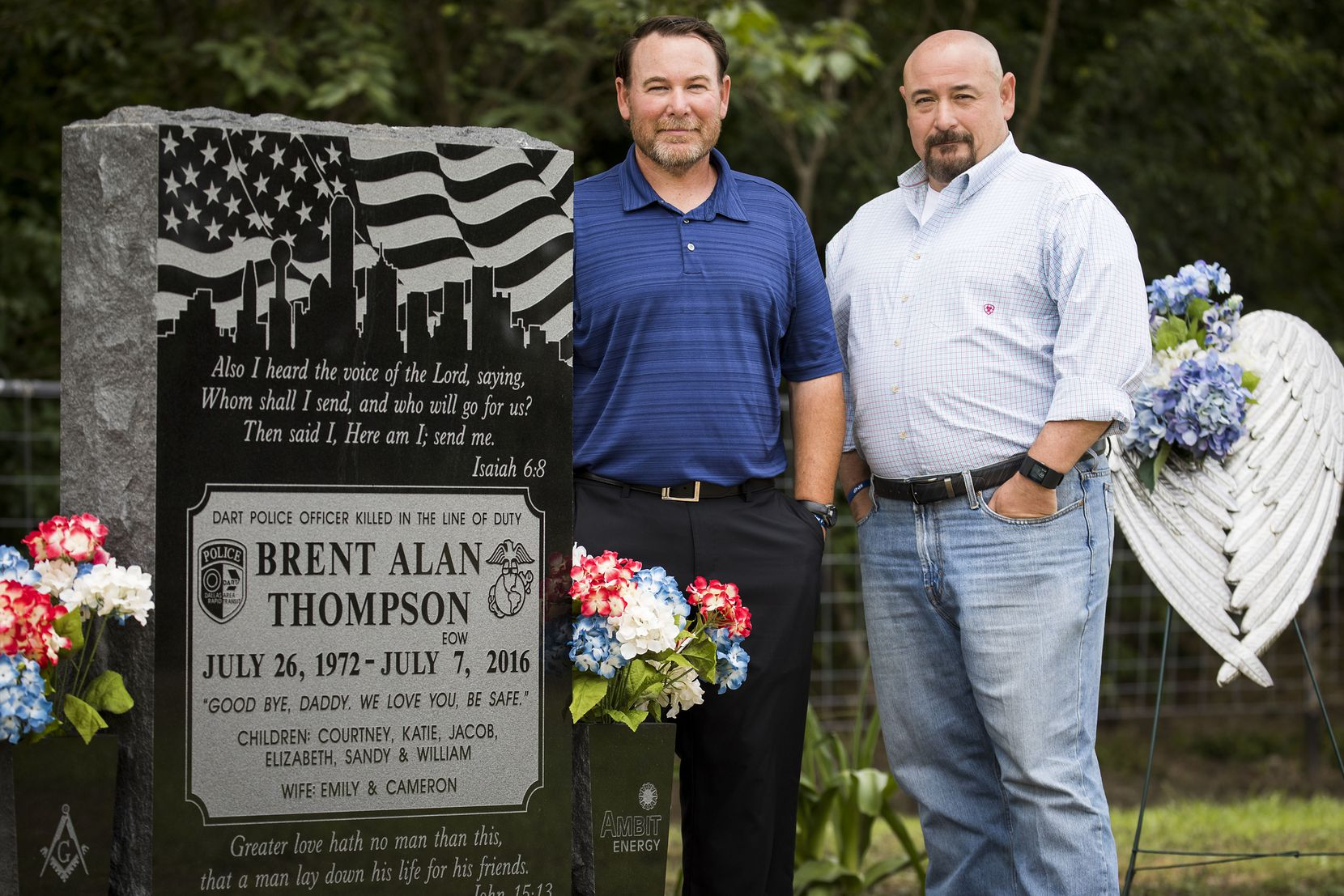 Lowell (right) and Daryl Thompson, the brothers of fallen DART police officer Brent Thompson, photographed at his gravesite on Sunday, June 25, 2017, in Frost.