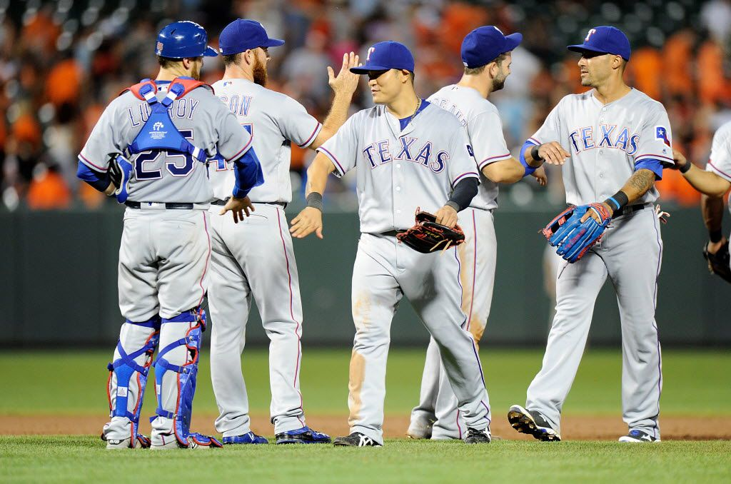 BALTIMORE, MD - AUGUST 04:  The Texas Rangers celebrate after a 5-3 victory against the Baltimore Orioles at Oriole Park at Camden Yards on August 4, 2016 in Baltimore, Maryland.  (Photo by Greg Fiume/Getty Images)