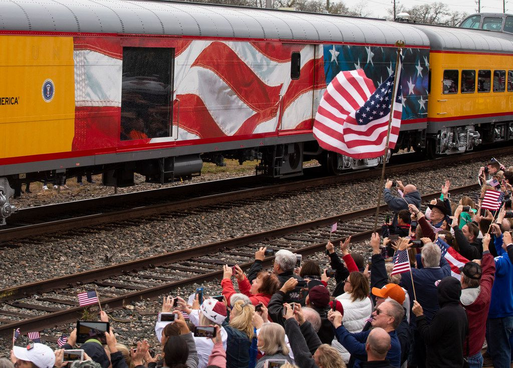 Mourners watch as a train carrying the remains of former President George H.W. Bush in Magnolia, Texas on Wednesday, December 6, 2018. The train traveled along the Union Pacific Corp. rail line from Spring to College Station. Bush died on November 30, 2018.