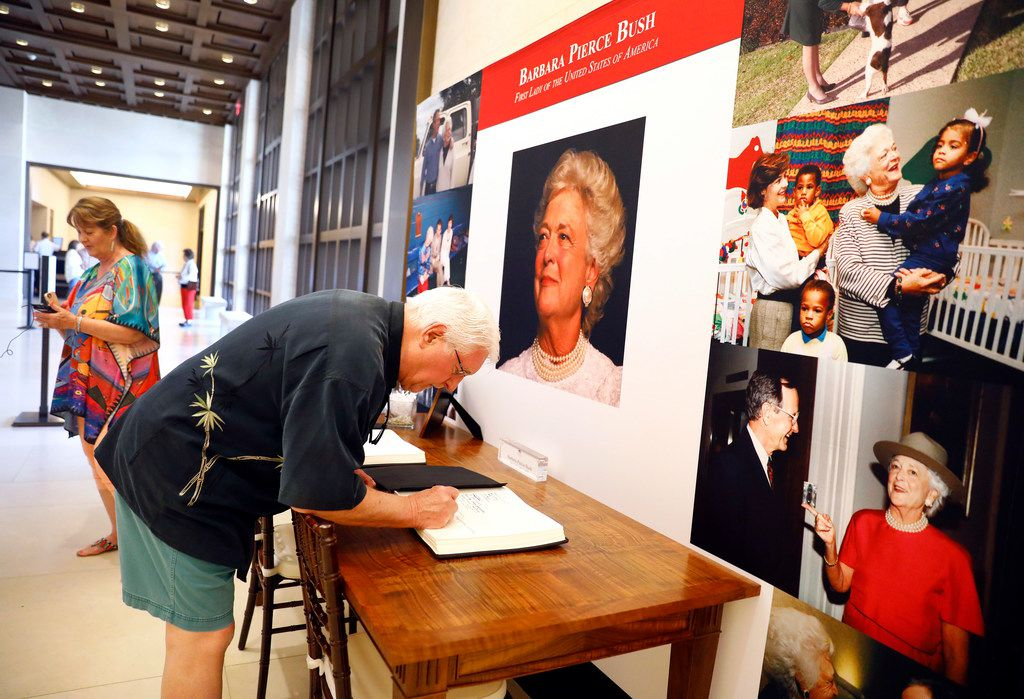 Bob Wilson of Sugar Land signed a memory book for former first lady Barbara Bush on Wednesday as he visited the exhibit with his wife Dianne at the George W. Bush Presidential Center in University Park.