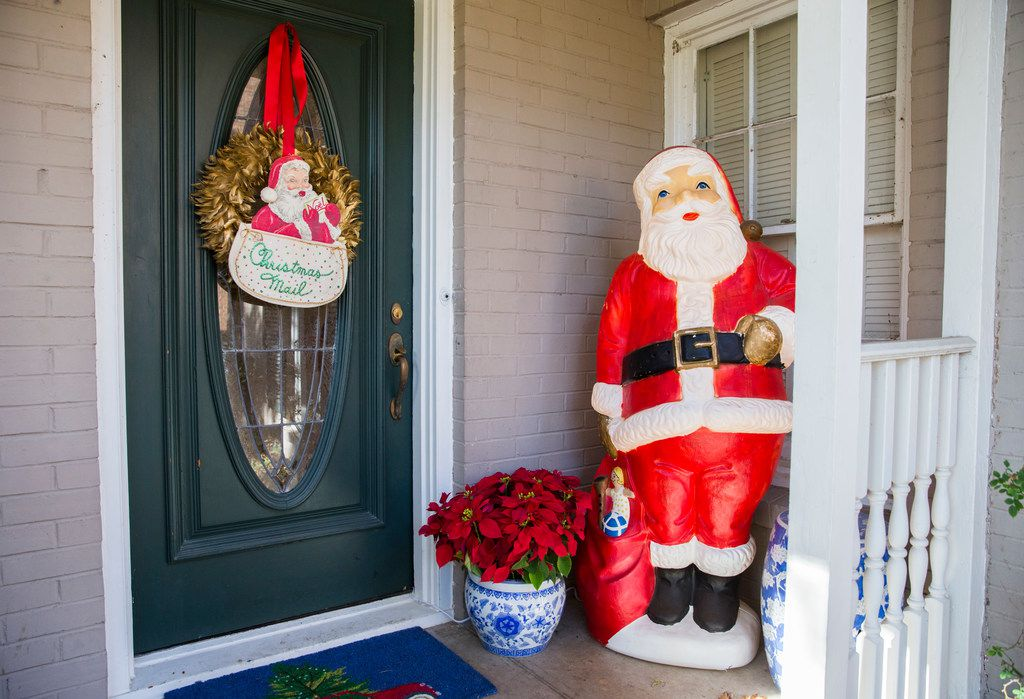 A large Santa figure is part of a collection of vintage Christmas ornaments and decorations at Caroline Nelson's home.