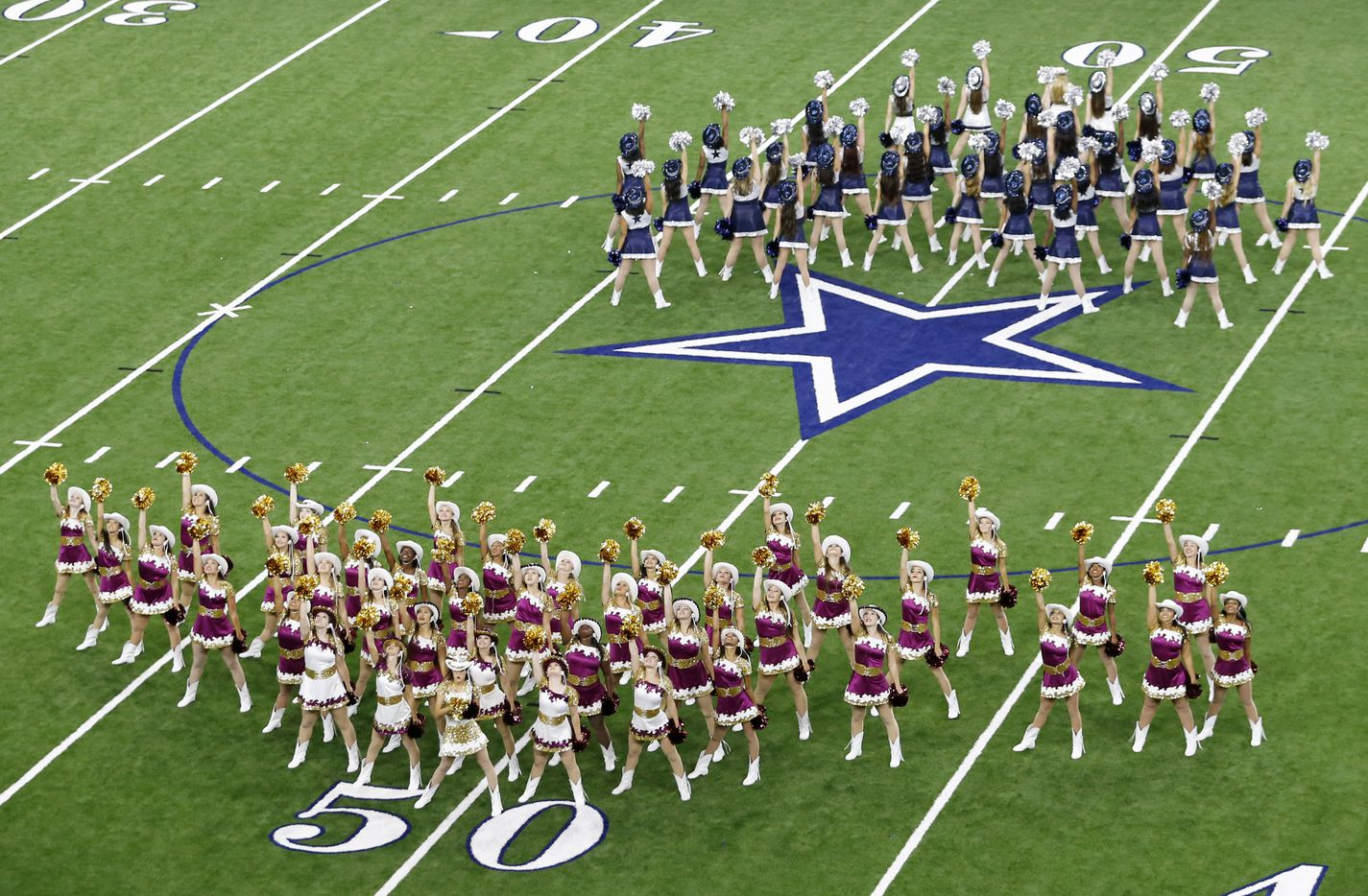 Heritage High School and Lone Star High School perform simultaneously during halftime during the second of four games played at The Star in Frisco on Saturday, August 27, 2016. (Vernon Bryant/The Dallas Morning News)