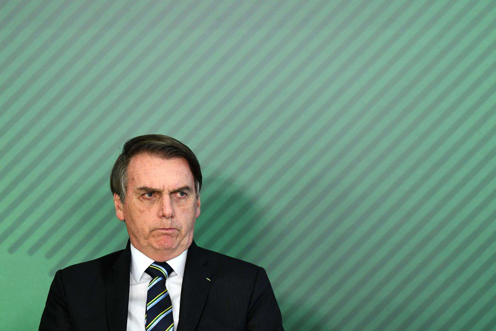 In this photo taken on April 9, 2019 Brazilian President Jair Bolsonaro gestures during the appointment ceremony of his new Education Minister Abraham Weintraub at Planalto Palace in Brasilia. - Students and professors are scheduled to march on May 10, 2019 against public education funding cuts. Jair Bolsonaro's ultraconservative government sparked outrage when it revealed on April 30 at least 30 percent cuts to the annual budgets of federally-funded high schools and universities. He's scheduled to visit Dallas on Thursday, May 16.