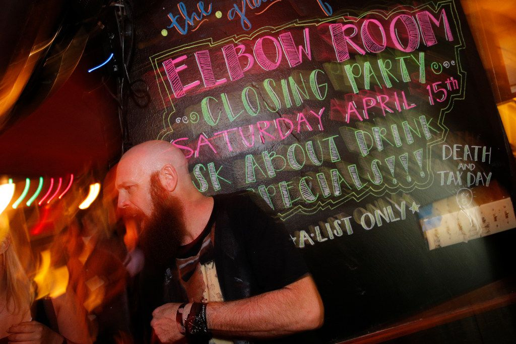 Bartender, Handsome Shawn talks to customers during the last hours of operation of the Elbow Room in Dallas on April 16, 2017. (Nathan Hunsinger/The Dallas Morning News)