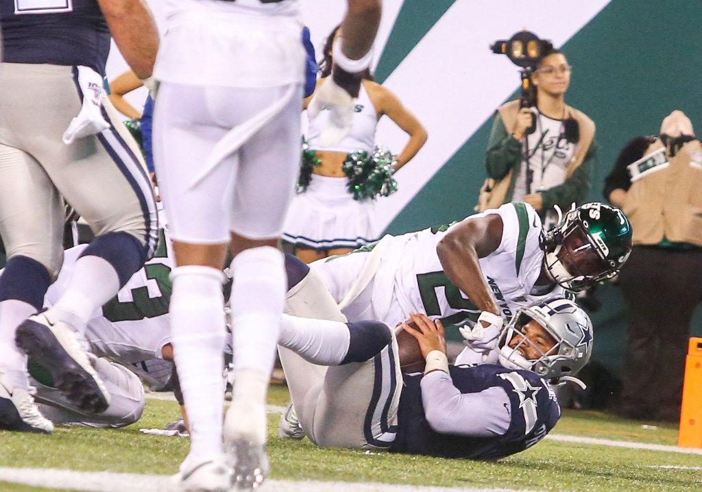 Dallas Cowboys quarterback Dak Prescott (4) scores a touchdown as he is defended by New York Jets free safety Marcus Maye (20) during the second half of an NFL game between the Dallas Cowboys and New York Jets on Sunday, October 13, 2019 at MetLife Stadium in East Rutherford, New Jersey.