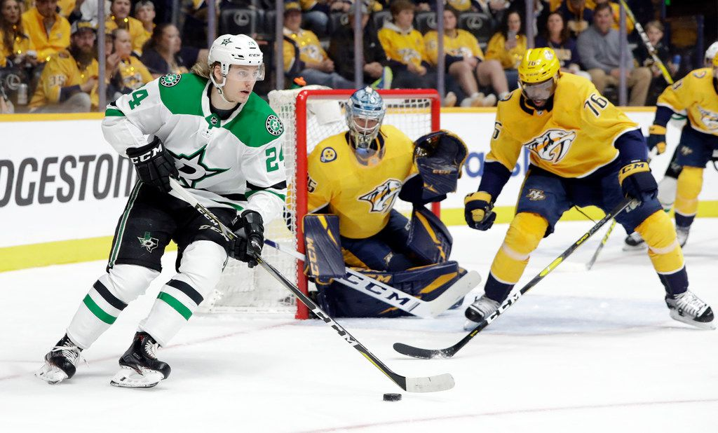 Dallas Stars right wing Roope Hintz (24), of Finland, moves the puck as Nashville Predators goaltender Pekka Rinne (35), also of Finland, and defenseman P.K. Subban (76) watch during the first period in Game 2 of an NHL hockey first-round playoff series Saturday, April 13, 2019, in Nashville, Tenn. (AP Photo/Mark Humphrey)