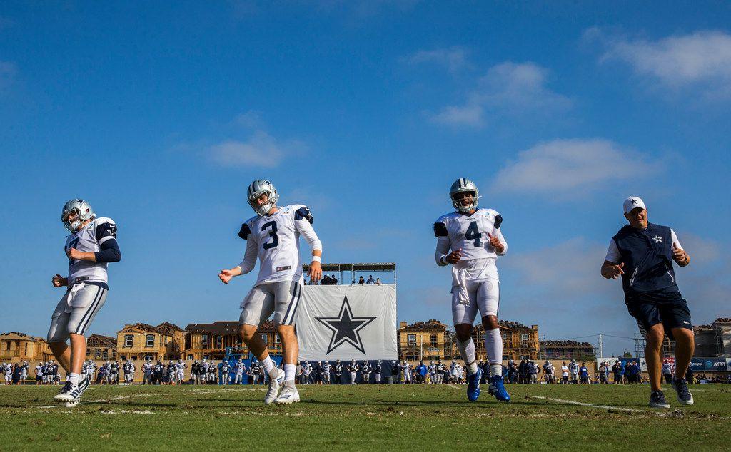 Dallas Cowboys quarterback Cooper Rush (7), quarterback Mike White (3) quarterback Dak Prescott (4) and quarterback coach Jon Kitna run during an afternoon practice at training camp in Oxnard, California on Monday, August 12, 2019. (Ashley Landis/The Dallas Morning News)