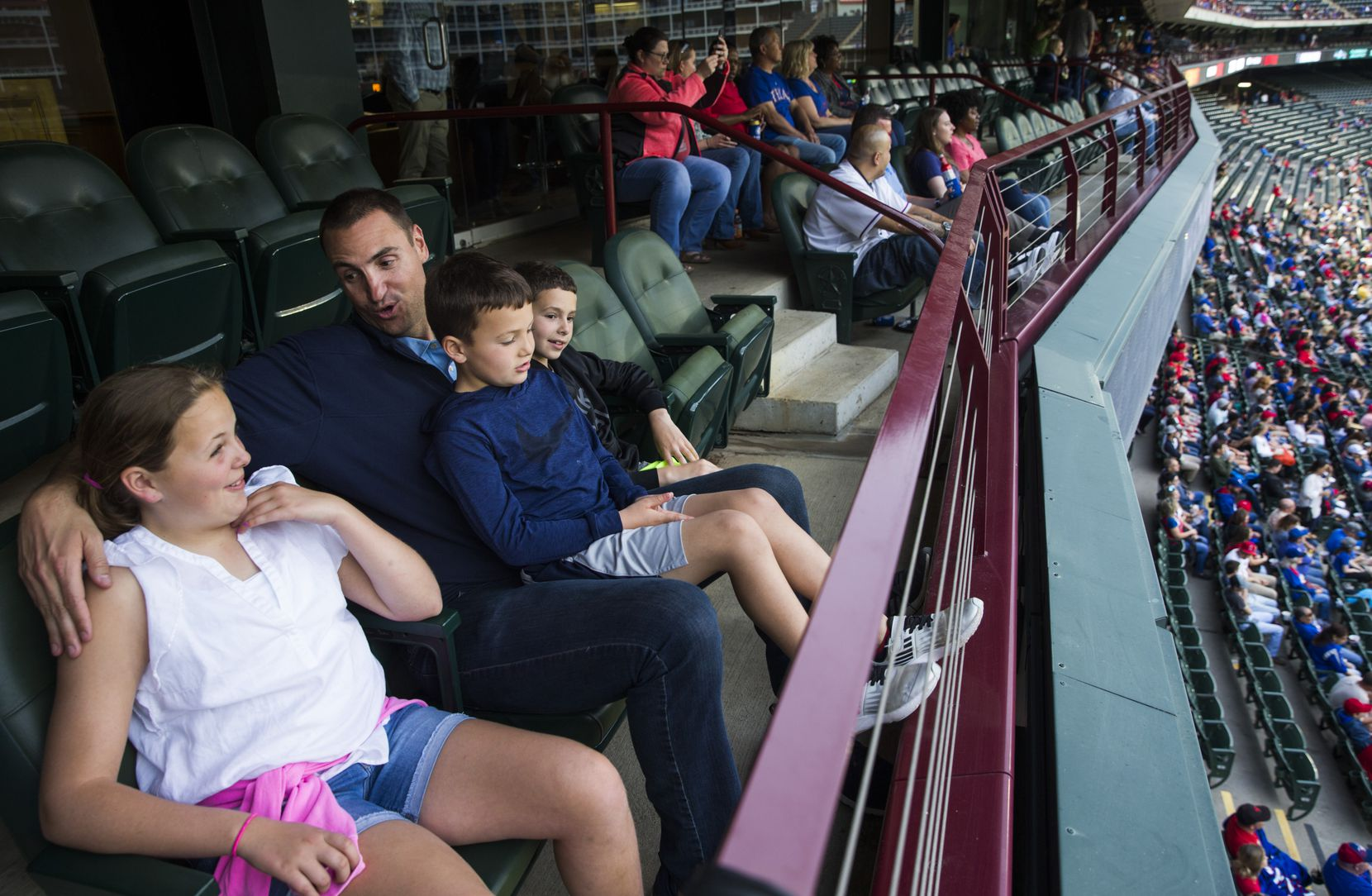 Former MLB pitcher Chris Young sits in a suite with his children, Cate Young, 11, Grant Young, 6, and Scott Young, 8, during the first inning of an MLB game between the Texas Rangers and the Los Angeles Angels on Tuesday, April 16, 2019 at Globe Life Park in Arlington. (Ashley Landis/The Dallas Morning News)