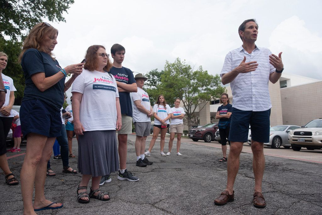 Nathan Johnson (right) talks with volunteers before they set out to canvass a neighborhood on Monday, Sept. 3, 2018.  He is running against Don Huffines for the Texas Senate in District 16.