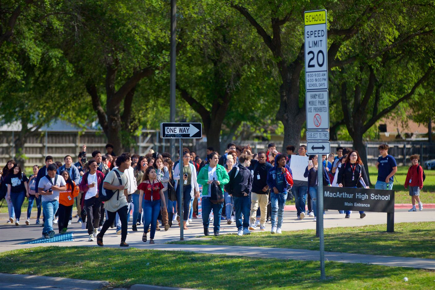 Students walkout of MacArthur High School in Irving to protest gun violence, Friday, April 20, 2018.