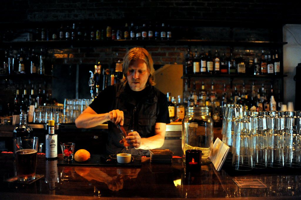 Bartender Khurk Maeder muddles a cocktail at Eight Bells Alehouse in Expo Park Dallas, TX on August 29, 2015.