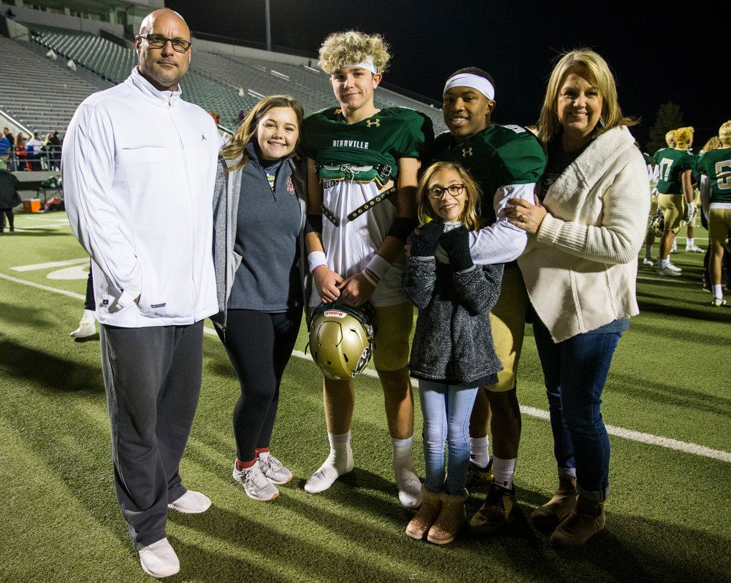 From left, John Earle, Ali Earle, Birdville quarterback Stone Earle (3), running back Laderrious Mixon (9), Gabby Earle and Josie Earle pose for a photo after a high school football game between Birdville and Fort Worth Boswell on Thursday, November 15, 2018 at the Birdville Fine Arts Center in North Richland Hills, Texas. The Earle family took in Mixon. (Ashley Landis/The Dallas Morning News)