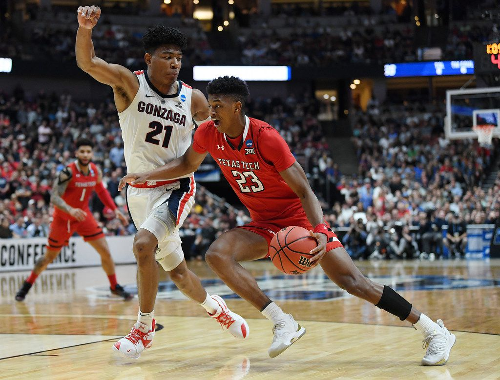 ANAHEIM, CALIFORNIA - MARCH 30: Jarrett Culver #23 of the Texas Tech Red Raiders drives against Rui Hachimura #21 of the Gonzaga Bulldogs during the second half of the 2019 NCAA Men's Basketball Tournament West Regional at Honda Center on March 30, 2019 in Anaheim, California. (Photo by Harry How/Getty Images)