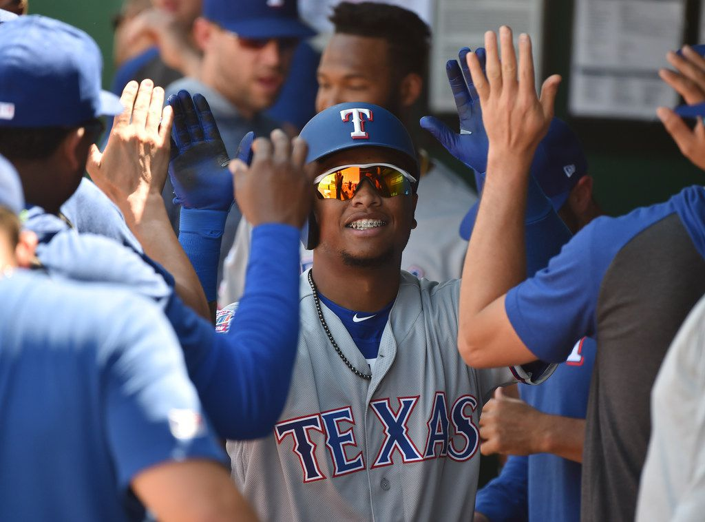 KANSAS CITY, MISSOURI - MAY 16:  Willie Calhoun #5 of the Texas Rangers celebrates his home run with teammates in the seventh inning against the Kansas City Royals at Kauffman Stadium on May 16, 2019 in Kansas City, Missouri. (Photo by Ed Zurga/Getty Images)