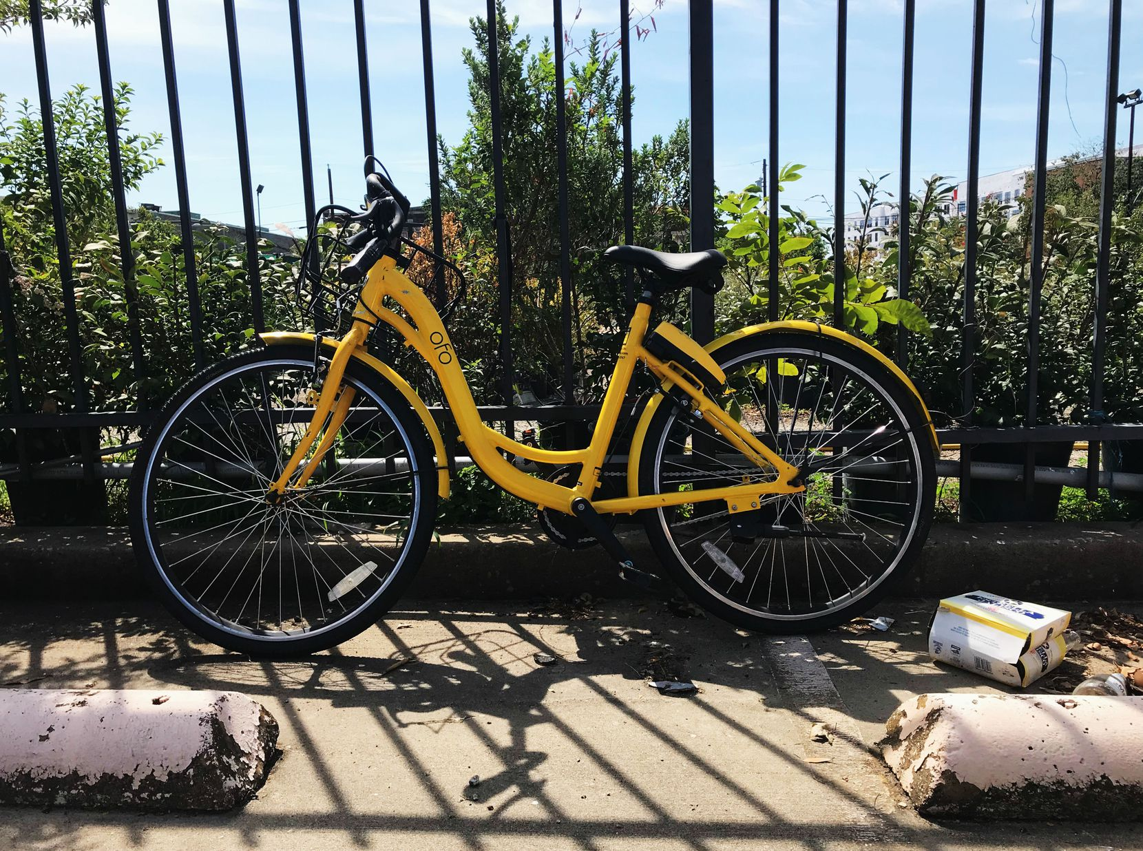 An abandoned Ofo bike in a parking lot in Downtown Dallas. Just imagine if this was a common sight around Dallas now, rather than a rarity.