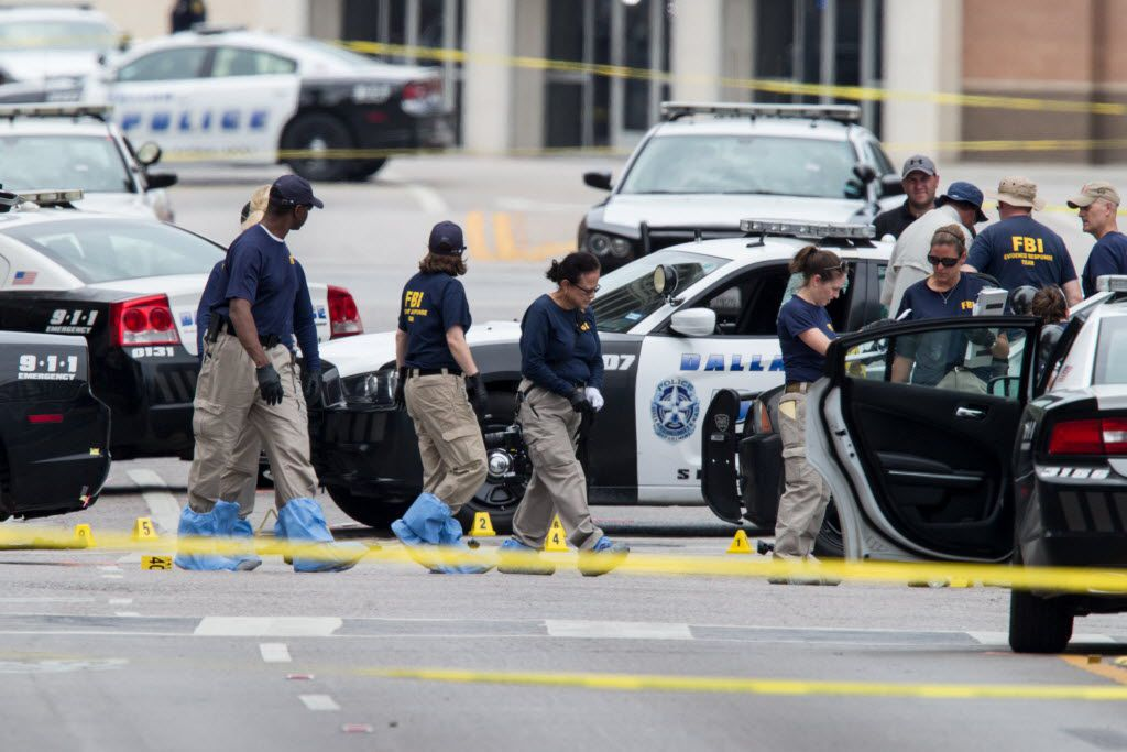 FBI investigators gathered evidence Saturday in downtown Dallas where a gunman opened fire on officers, killing five and wounding several others.