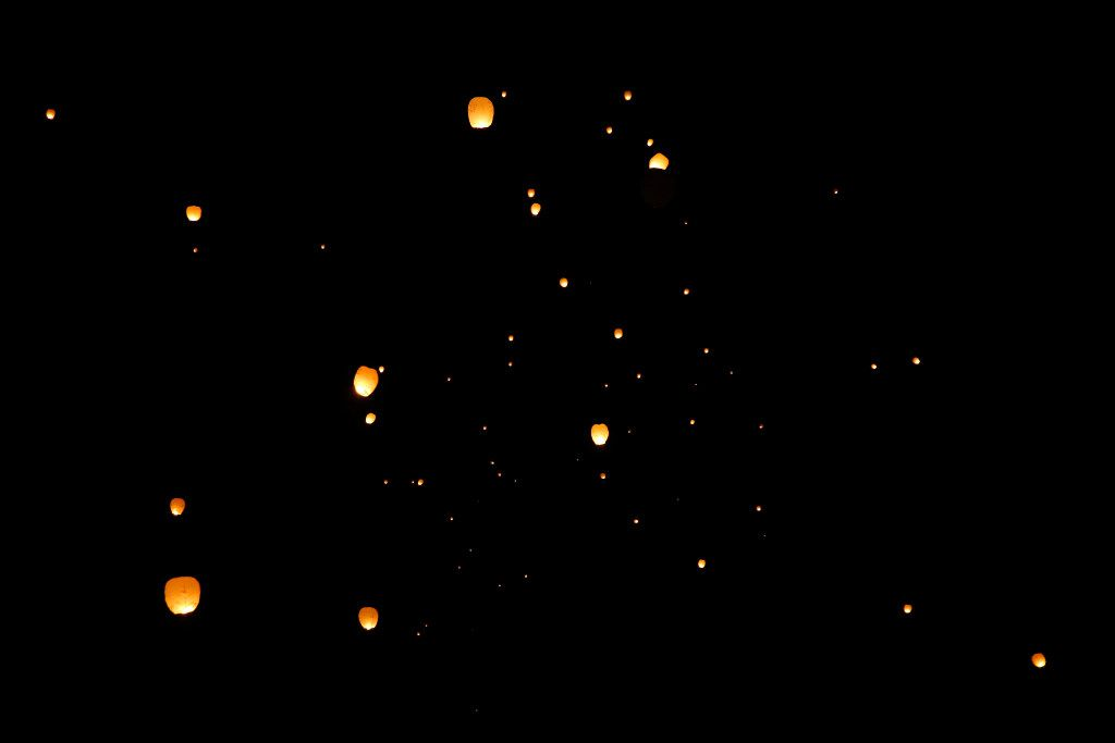 Fueled by a small burning ember, lighted paper lanterns float away into the night sky during the Lantern Festival at Texas Motorplex in Ennis, Texas, Saturday evening, March 4, 2017. (Tom Fox/The Dallas Morning News)