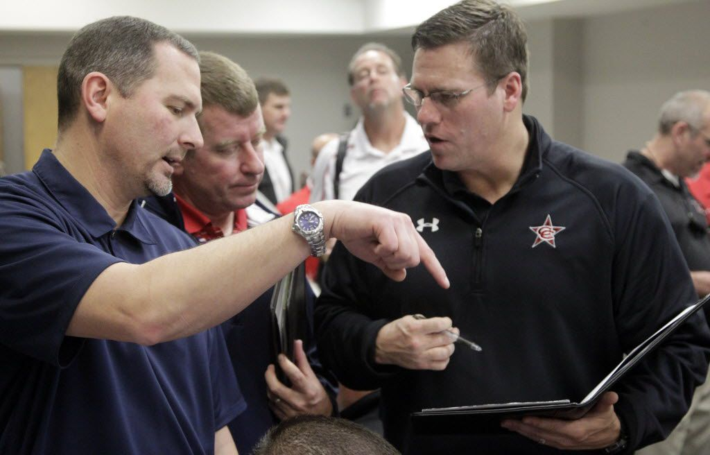 Football coaches (l to r) Don Drake (McKinney Boyd), Tom Westerberg (Allen) and Joe McBride (Coppell) try to schedule games against each other during the UIL's  biennial realignment announced at the Birdville Fine Arts/ Athletic Complex on Thursday, February 02, 2012.  (Michael Ainsworth/The Dallas Morning News) 02032012xSPORTS