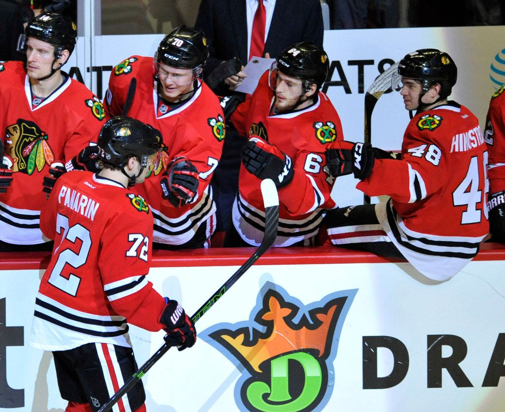 Chicago Blackhawks' Artemi Panarin (72) of Russia, celebrates with teammates on the bench after scoring during the third period of an NHL hockey game against the Dallas Stars Sunday, Dec. 11, 2016, in Chicago. Chicago won 3-1. (AP Photo/Paul Beaty)