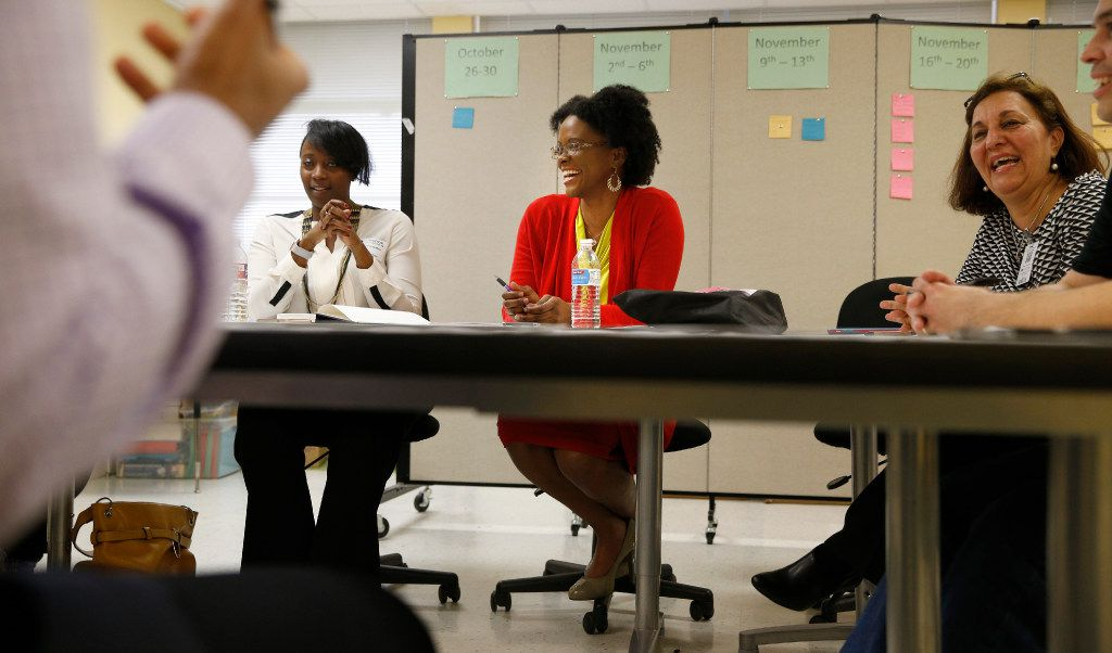 Kristin Bolton (from left), Alicia Morgan and Mansourch Ahmadian-Tehrani meet as members of the advisory board of the nationally certified Academies of Engineering and Biomedical Sciences at Bryan Adams High School. (Nathan Hunsinger/Staff Photographer)