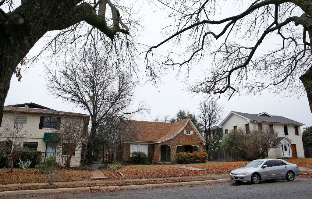 The homes designated to be leveled to make room for a parking garage at Snider Plaza in Dallas on January 18, 2017. University Park city council approved plans to build an underground parking facility for Snider Plaza business owners and employees to alleviate the current parking and traffic problems in the area.