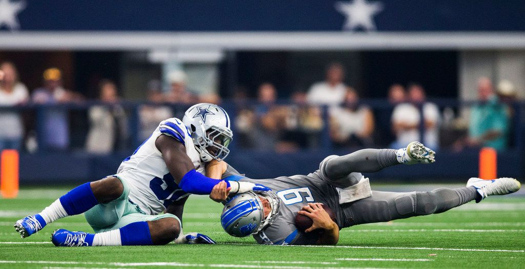 Dallas Cowboys defensive end Demarcus Lawrence (90) sacks Detroit Lions quarterback Matthew Stafford (9) during the second quarter of an NFL football game between the Dallas Cowboys and the Detroit Lions on Sunday, September 30, 2018 at AT&T Stadium in Arlington, Texas. (Ashley Landis/The Dallas Morning News)