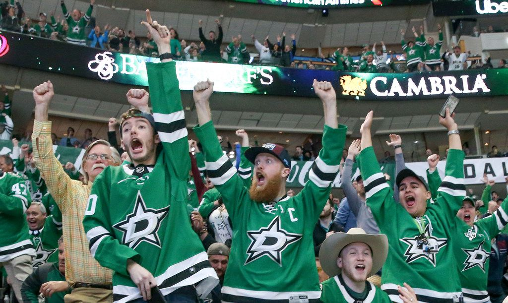 Dallas Stars fans celebrate after the Stars scored during the second period of an NHL hockey game at American Airlines Center in Dallas on Tuesday, April 2, 2019. (Shaban Athuman/The Dallas Morning News)