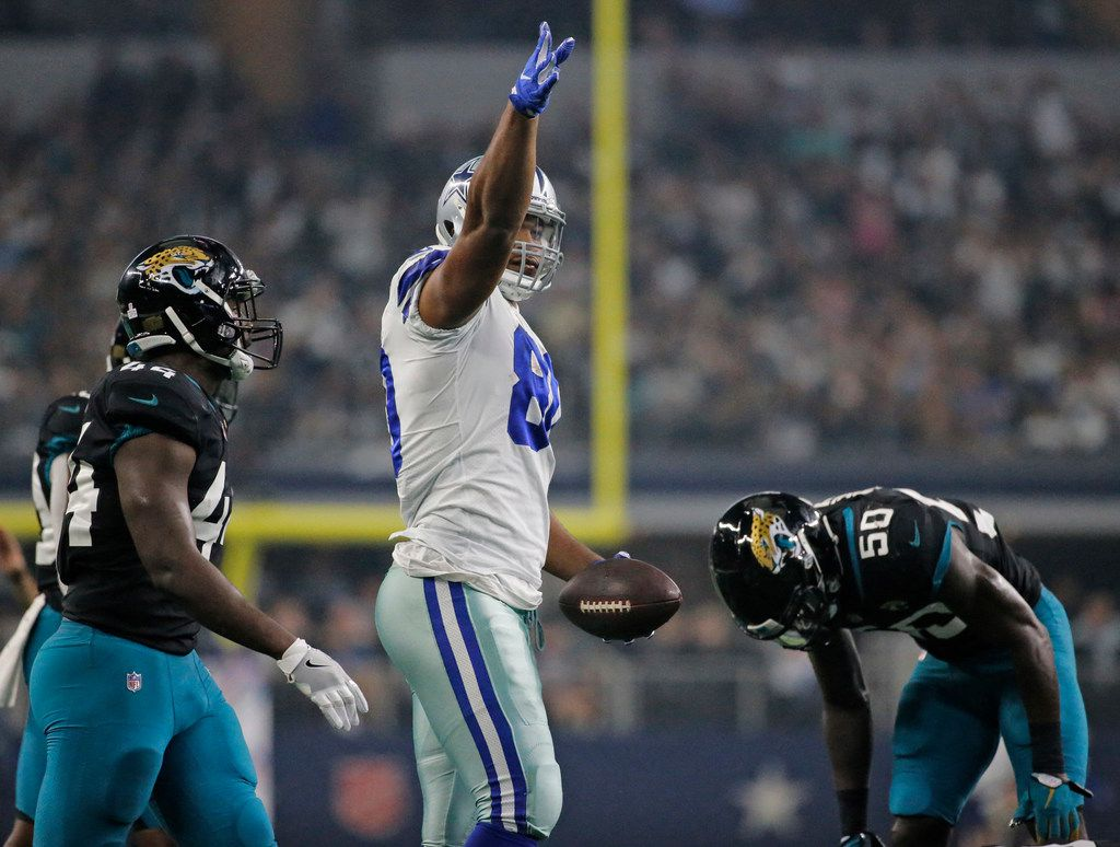 Dallas Cowboys tight end Rico Gathers (80) signals a first down after his pass reception during the Jacksonville Jaguars vs. the Dallas Cowboys NFL football game at AT&T Stadium in Arlington, Texas on Sunday, October 14, 2018. (Louis DeLuca/The Dallas Morning News)