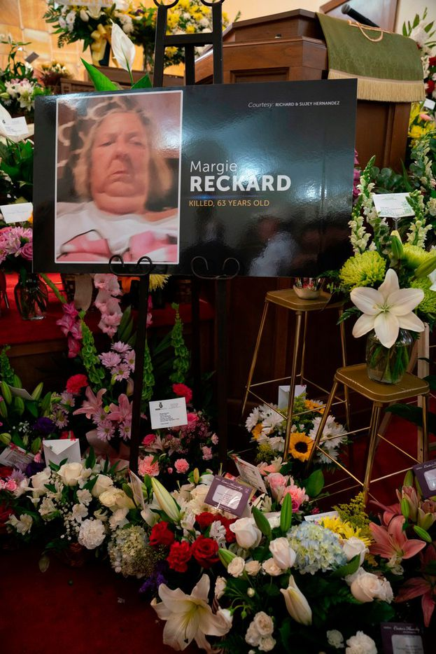 Flowers for El Paso Walmart shooting victim Margie Reckard alongside her photo inside La Paz Faith Center on the day of her visitation service in El Paso, Texas on August 16, 2019.