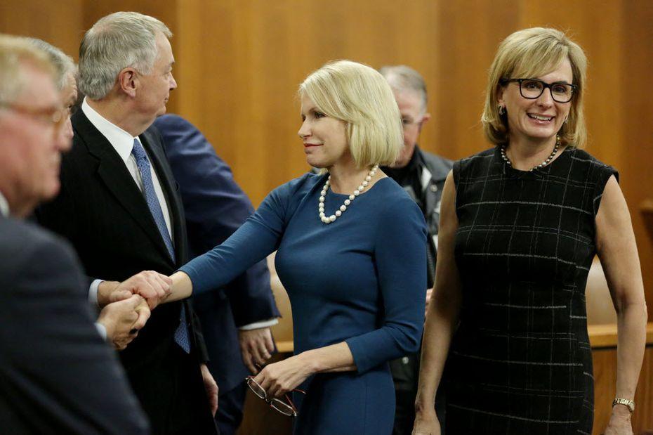 Dallas County District Attorney Susan Hawk (center) greets supporters while standing near Charla Aldous (right), who is part of her legal team, after State District Judge David Peeples, of San Antonio, dismissed a lawsuit to ouster Hawk from office at the George Allen Courts Building in Dallas Friday January 8, 2016. (Andy Jacobsohn/Staff Photographer)