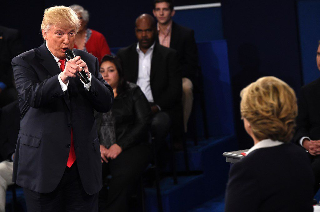 US Democratic Presidential nominee Hillary Clinton (R) and Republican Presidential nominee Donald Trump participate a town hall debate against Republican nominee Donald Trump at Washington University in St. Louis, Missouri, on October 9, 2016.