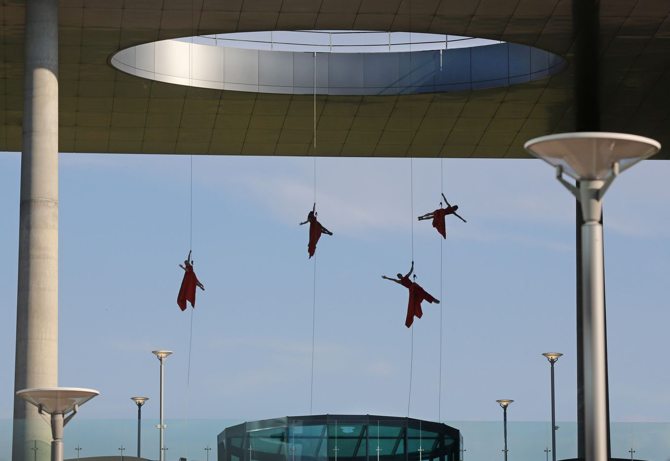 Aerial dancers perform while suspended from the Toyota building at the grand opening ceremony of the Toyota headquarters in Plano, Texas, photographed on Thursday, July 6, 2017.