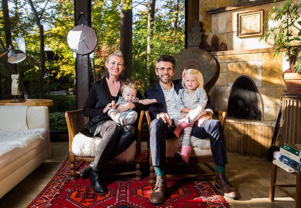 """Danielle and Scott Kaserman and their daughters Gianna, 5 months, and Isabella, 3, pose for a photo in the living room of their Airbnb house affectionately known as the """"tree house"""" on Nov. 13, 2018. The home was named the most wish-listed Airbnb in Dallas."""