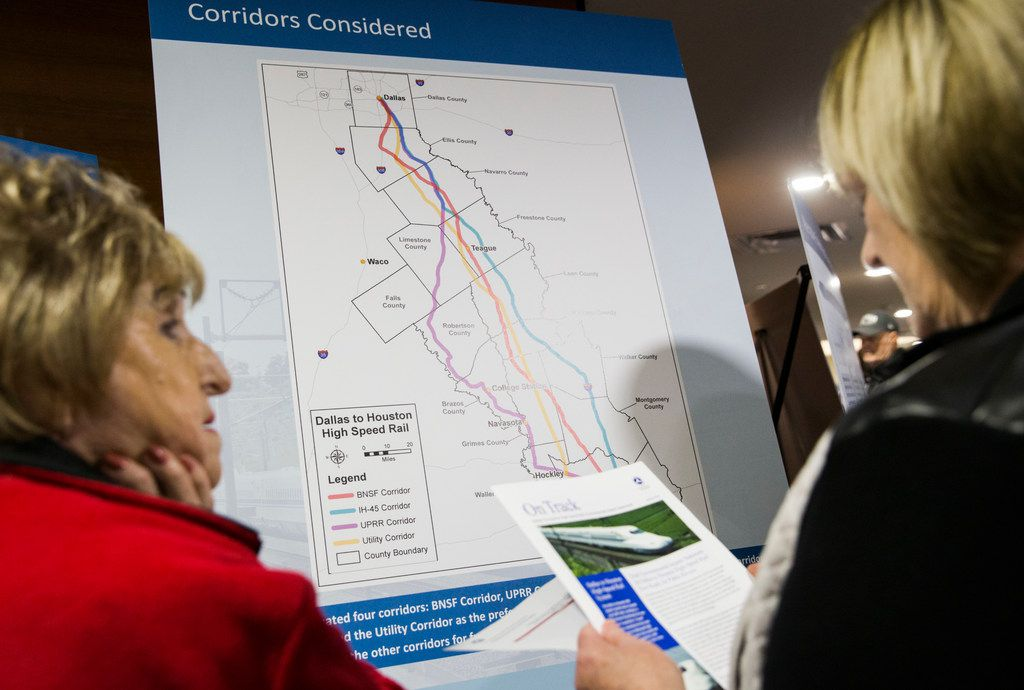 Two women look at a map of possible routes during an open house  to view plans and talk to company and corporate officials about a $15 billion Dallas to Houston high-speed rail line on Monday at Wilmer-Hutchins High School in Dallas. (Ashley Landis/The Dallas Morning News)