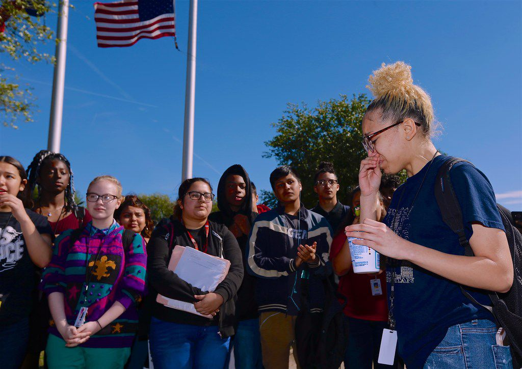 Junior Kealie Jordan (right) led her classmates in a sometimes emotional walkout at MacArthur High School in Irving.