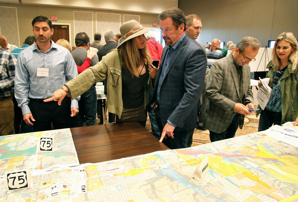 McKinney Mayor George Fuller (right) and wife Maylee looked over maps of possible U.S. Highway 380 alignment routes  during a public meeting at the Sheraton Hotel in McKinney in April.