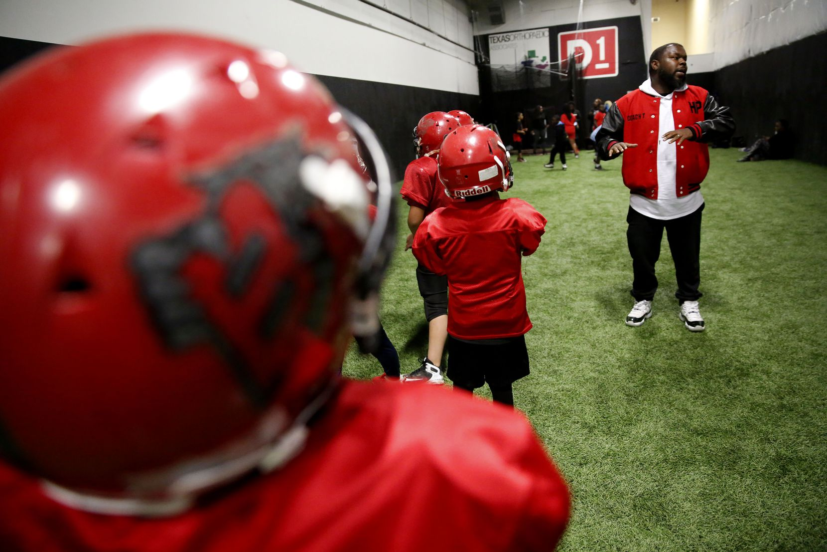 Tevar Watson coaches during a Hamilton Park Bobcats youth football league practice.