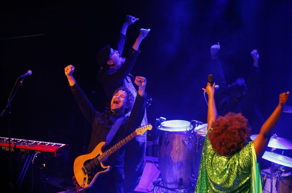 The Suffers raise their hands together at The Kessler Theater in Dallas Friday April 22, 2016. (Andy Jacobsohn/The Dallas Morning News)