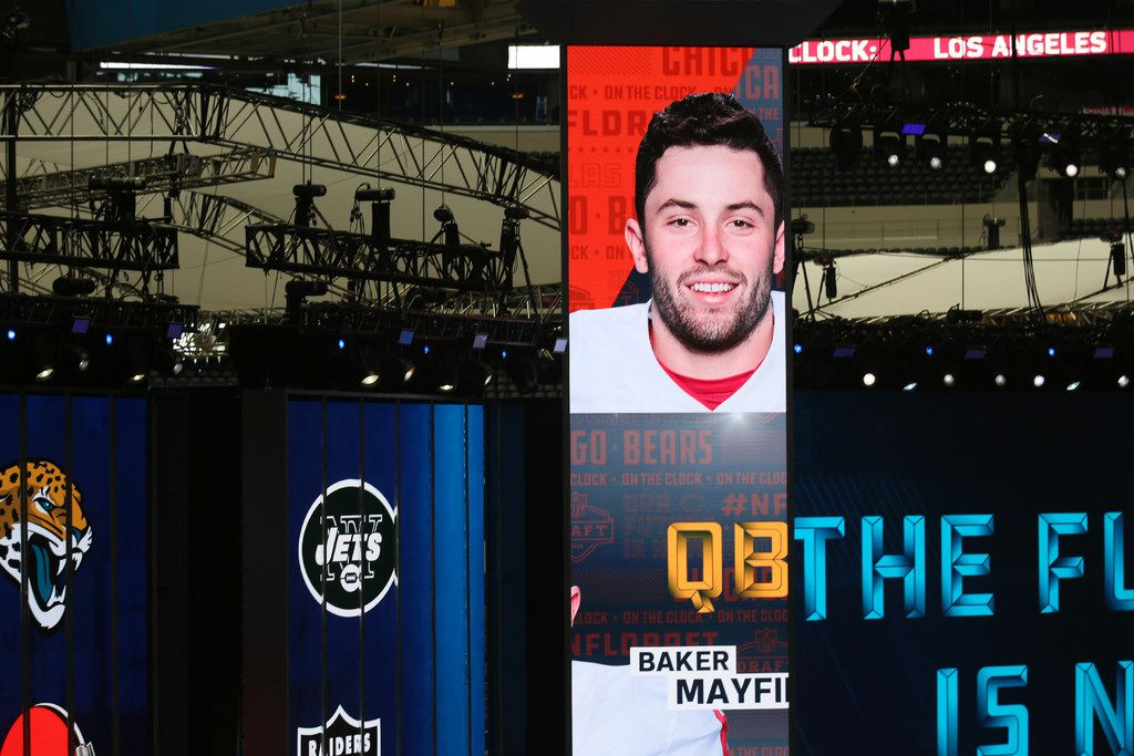 A photograph of Oklahoma quarterback Baker Mayfield is displayed inside of AT&T Stadium as preparations continue for the 2018 National Football League draft at the venue in Arlington, Texas Tuesday April 24, 2018. This is the first time an NFL draft is being held at a stadium. The draft starts Thursday and ends Saturday. (Andy Jacobsohn/The Dallas Morning News)