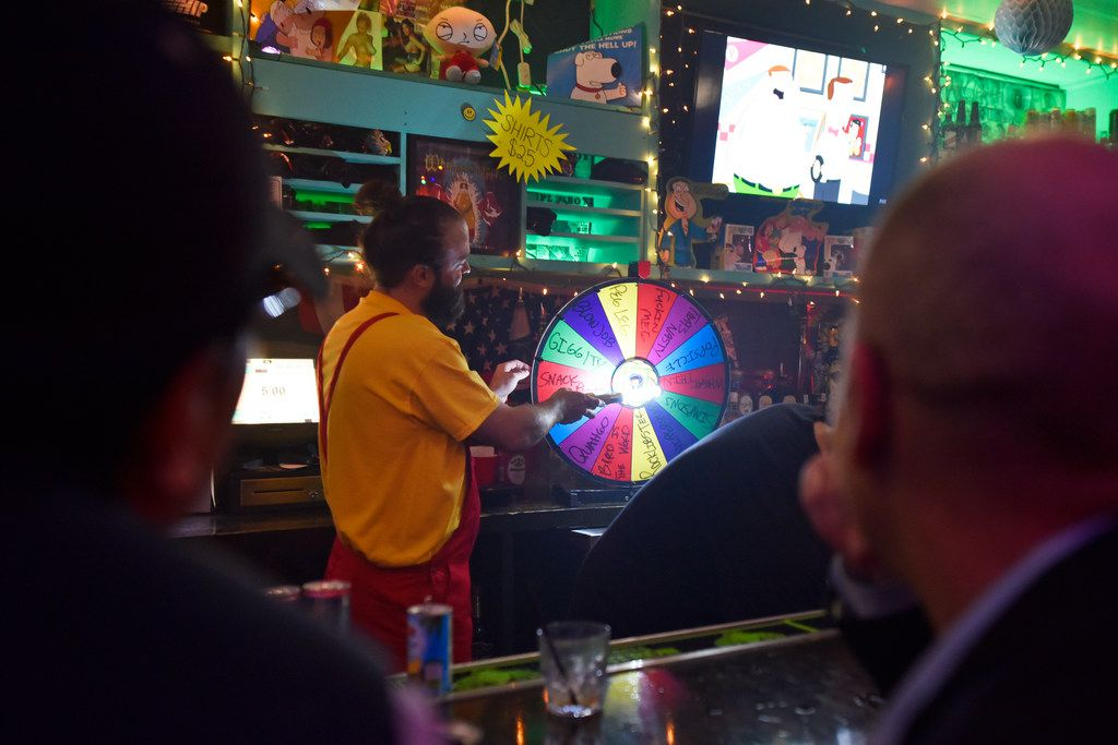 Bartender Chase Fieber uses a wheel to choose a $5 shot inside the pop-up bar the Drunken Clam, Thursday night Jan. 10, 2019 in Dallas. Drunken Clam is themed after the bar in Family Guy. Ben Torres/Special Contributor