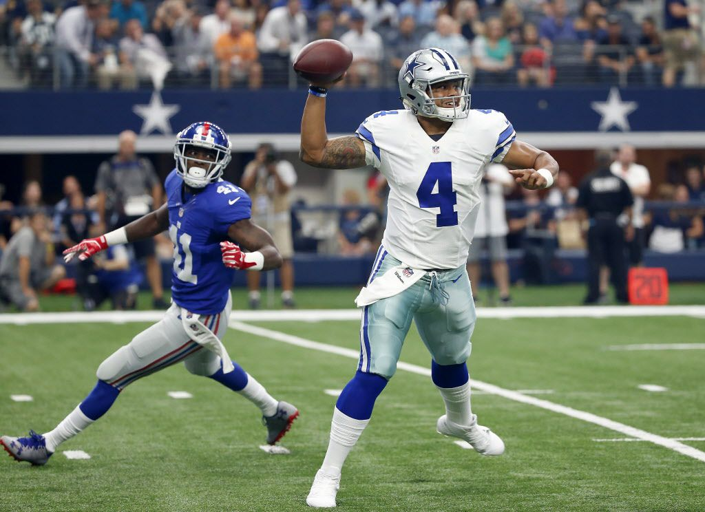 Dallas Cowboys quarterback Dak Prescott (4) throws the ball past New York Giants cornerback Dominique Rodgers-Cromartie during the first quarter at AT&T Stadium in Arlington, Texas, Sunday, Sept. 11, 2016. (Jae S. Lee/The Dallas Morning News)