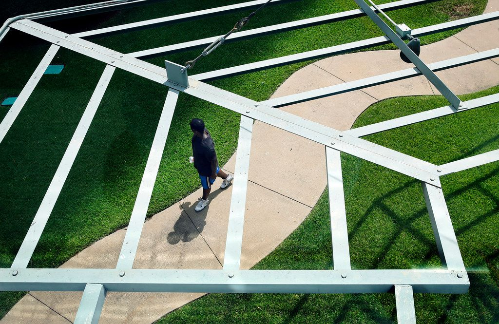 As temperatures soared to 107 degrees, a man walks through the Cancer Survivors Plaza in downtown Dallas, Friday, July 20, 2018. (Tom Fox/The Dallas Morning News)