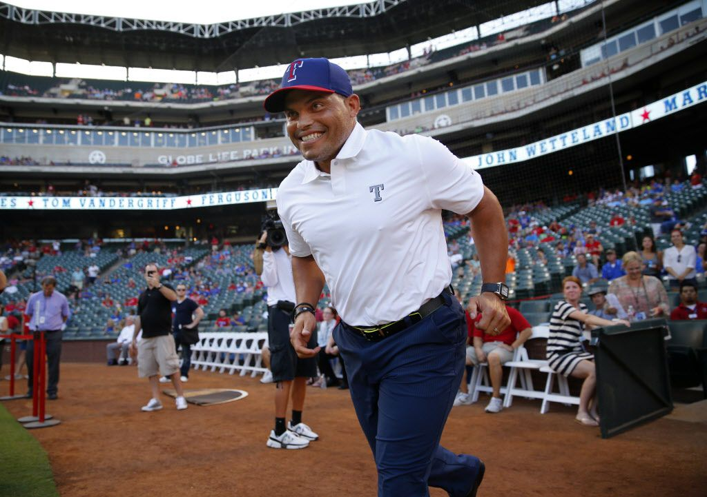 Former Texas Rangers player Ivan 'Pudge' Rodriguez  is introduced before the Texas Rangers Hall of Fame induction ceremony for former president Tom Schieffer at Globe Life Park in Arlington, Saturday, August 23, 2014. (Tom Fox/The Dallas Morning News)