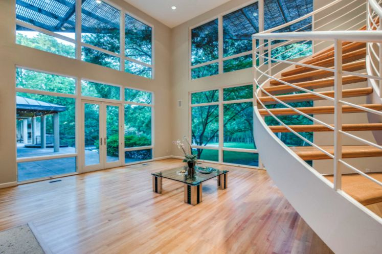 The North Dallas home has a floating staircase.