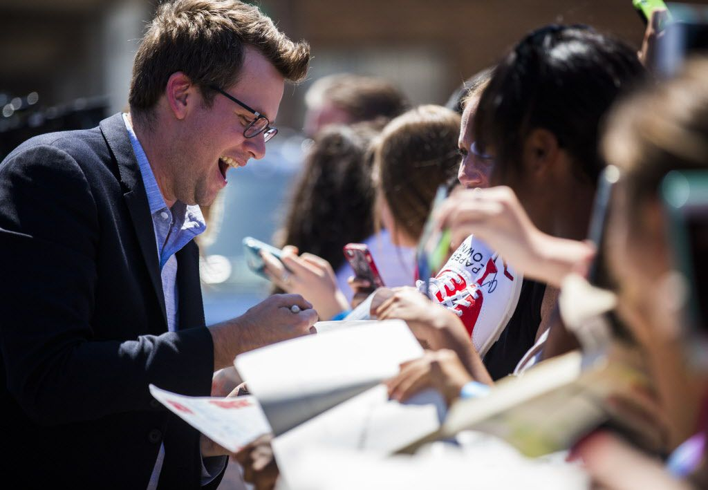 Author John Green signs autographs on the red carpet outside a promotional event for Paper Towns, a movie based on the book by John Green, on Thursday, July 16, 2015 at Bomb Factory in Dallas.