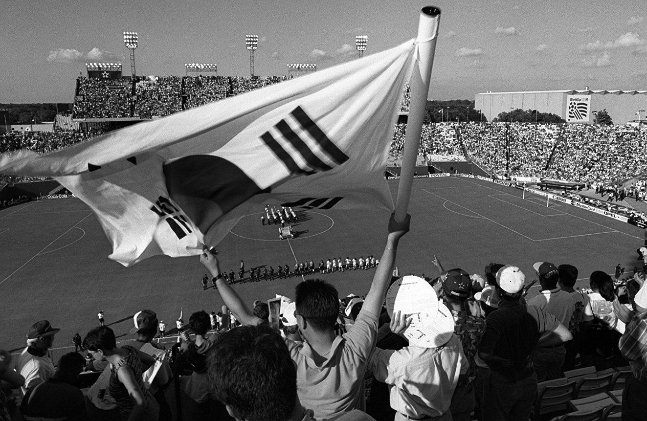 A fan waves a South Korean  flag before the start of the first World Cup game in Dallas between South Korea and Spain in 1994.