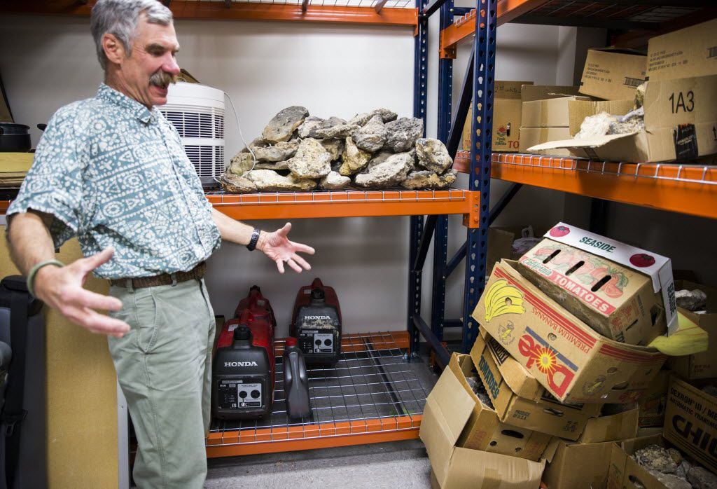 John Geissman, professor of geosciences, describes a large sample of rocks donated by John Tackle at the University of Texas at Dallas in Richardson.